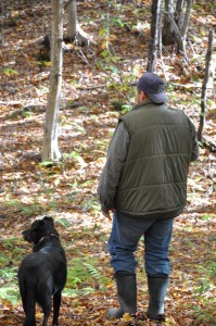 person and dog in woods